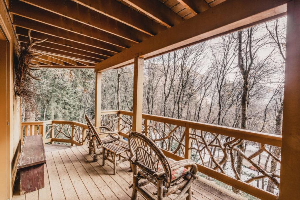 Deck of the three-story Sunstone Cabin at Sundance Mountain Resort.
