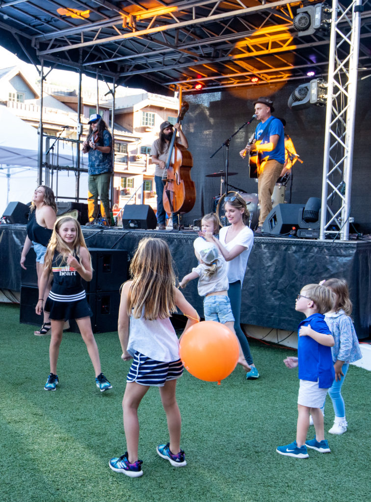 Children and families enjoy the music at a Vail Valley Bluegrass Music Festival in summer.