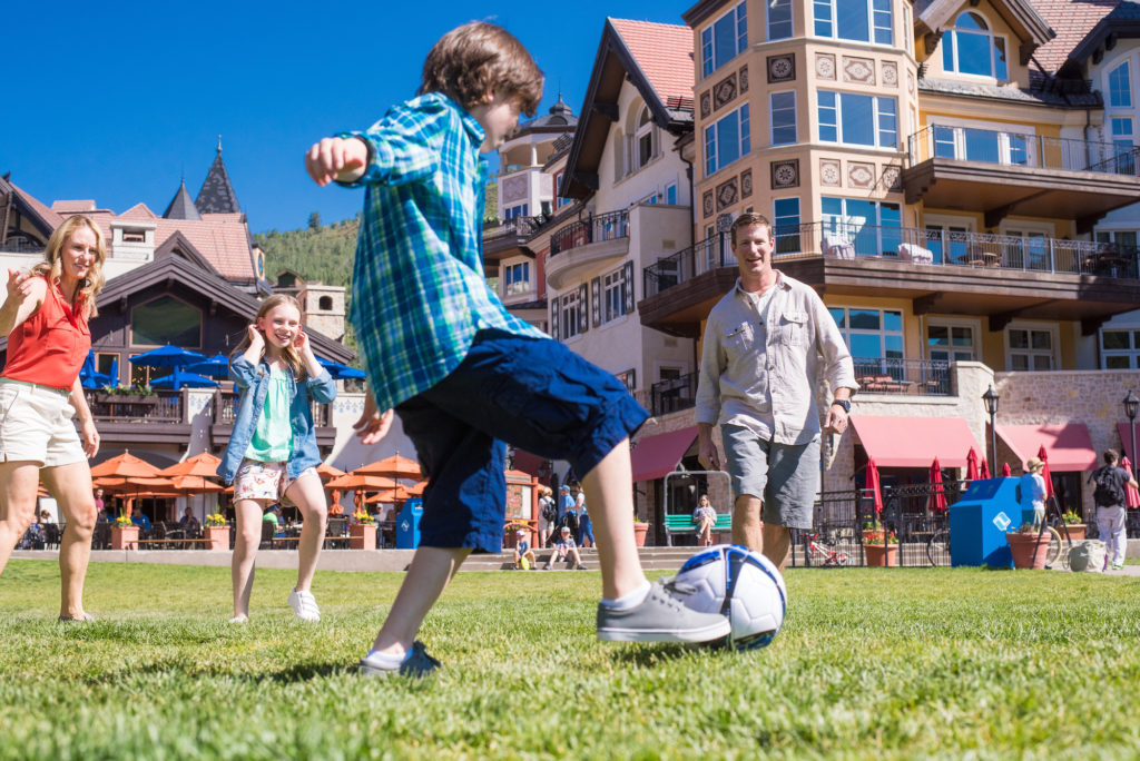 Casual family soccer game in the town square at Vail base village.