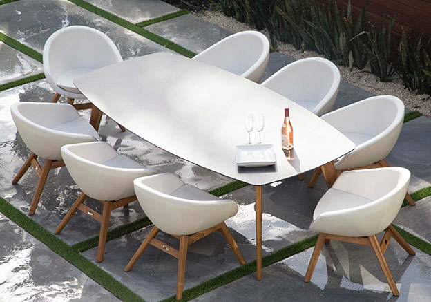 White table and chairs on a patio.