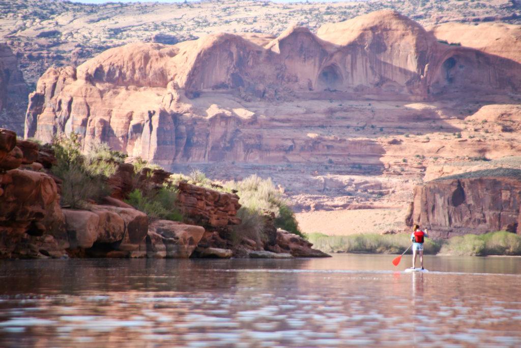 Paddleboarder alone in canyons of Canyonlands National Park, Moab, Utah