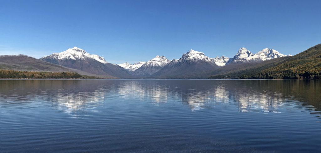 Natural vista of mountain views seen from Lake Apgar in Glacier National Park.