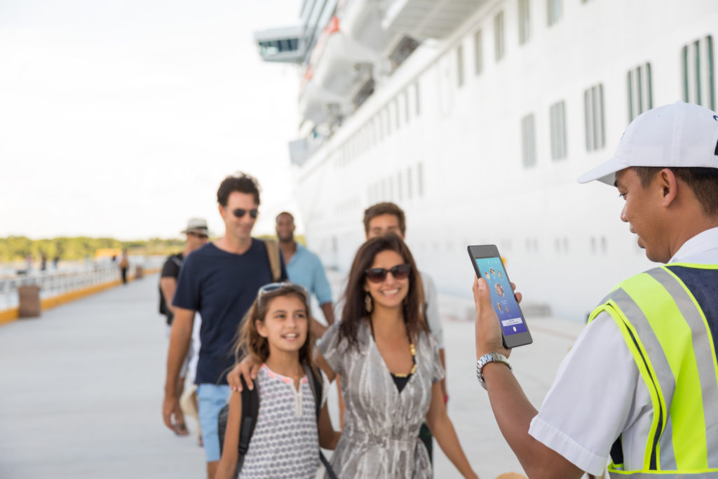 Princess Cruise Line guests embarking on their ship are greeted by staff.