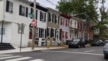 Two-story brick houses at the Intersection of Van Buren and Lovering Streets in Wilmington, Delaware.