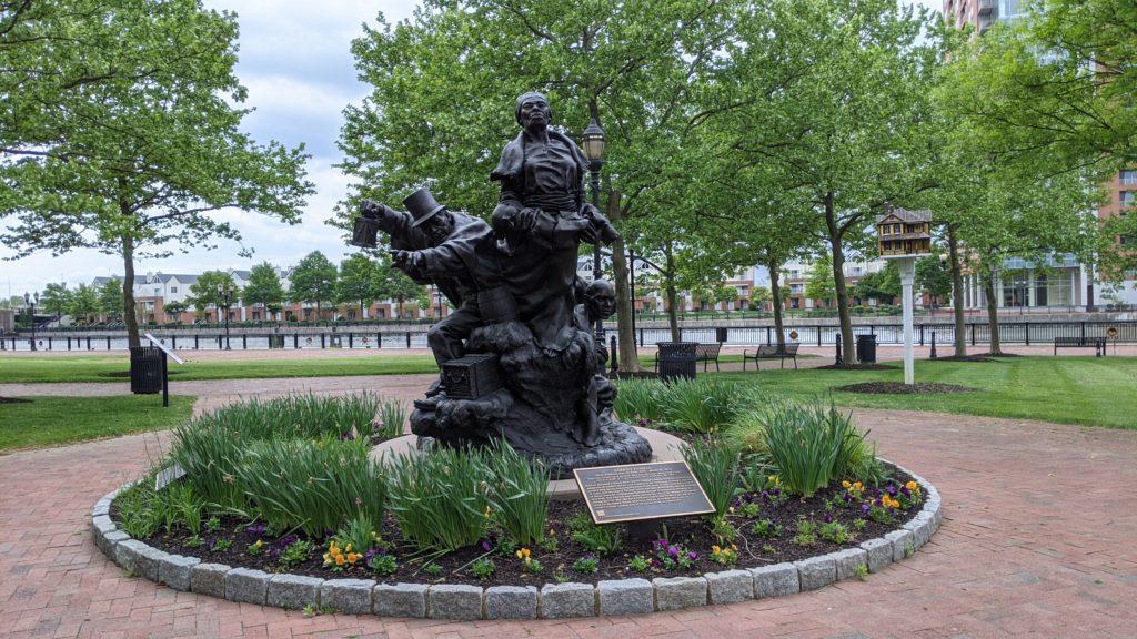 Larger than life bronze statue of Harriet Tubman and Thomas Garrett in Tubman Garret Riverfront Park, Wilmington, Delaware.