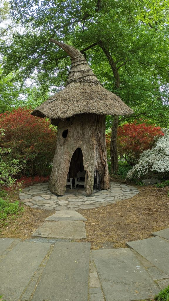 """Thatch roof house """"folly"""" in Winterthur's Enchanted Garden for children."""