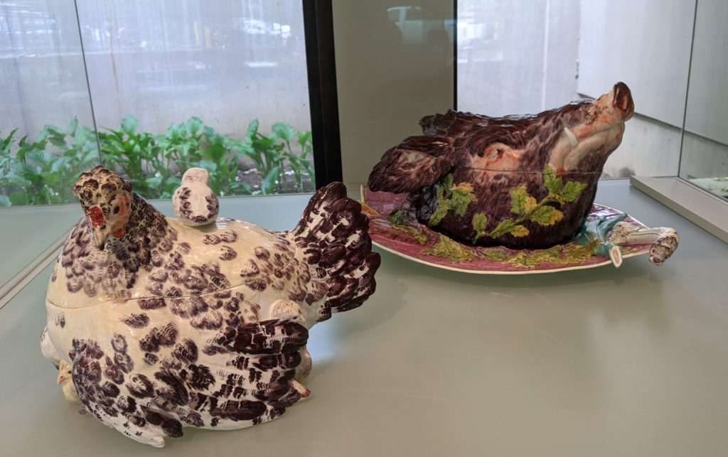Historic chicken and pig shaped soup tureens on display at Winterthur Galleries, Wilmington, Delaware.