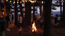 People around bonfire at lake, Sunny Hill Resort, Catskills Mountains, New York
