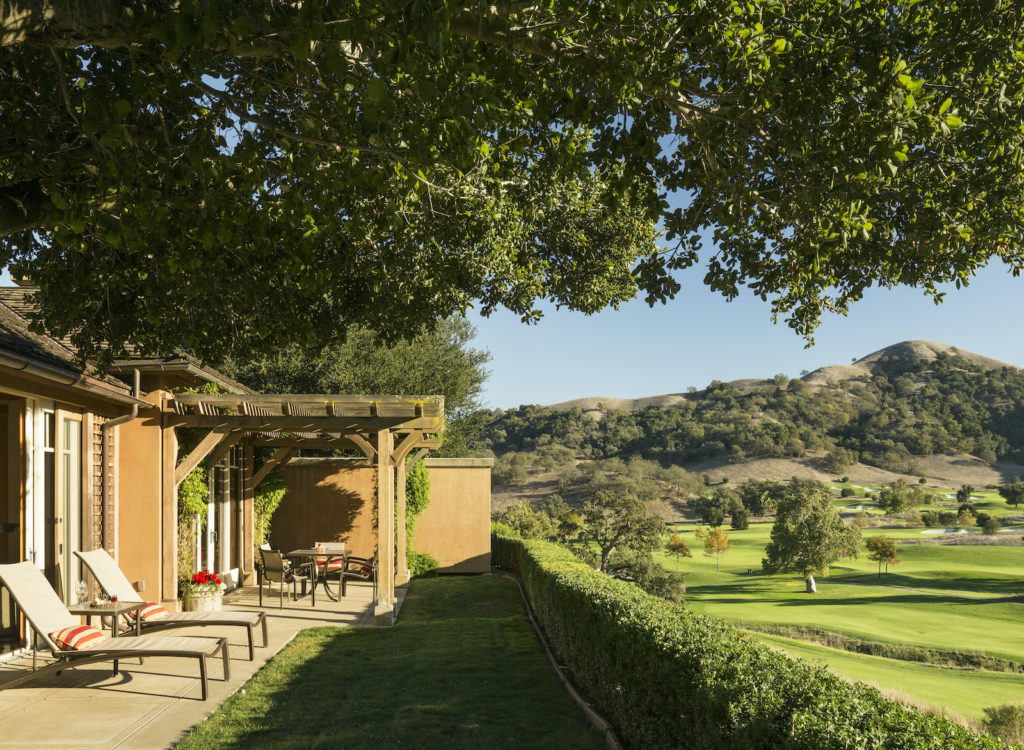 Guest quarters at CordeValle Resort with patio overlooking the hills.