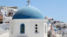 Blue dome church in Oia, Santorini, Greece.