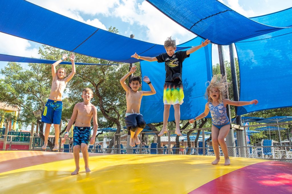 Kids bounce on a jumping pillow at the Jellystone Park Camp Resort at Canyon Lake, in the Texas Hill Country.