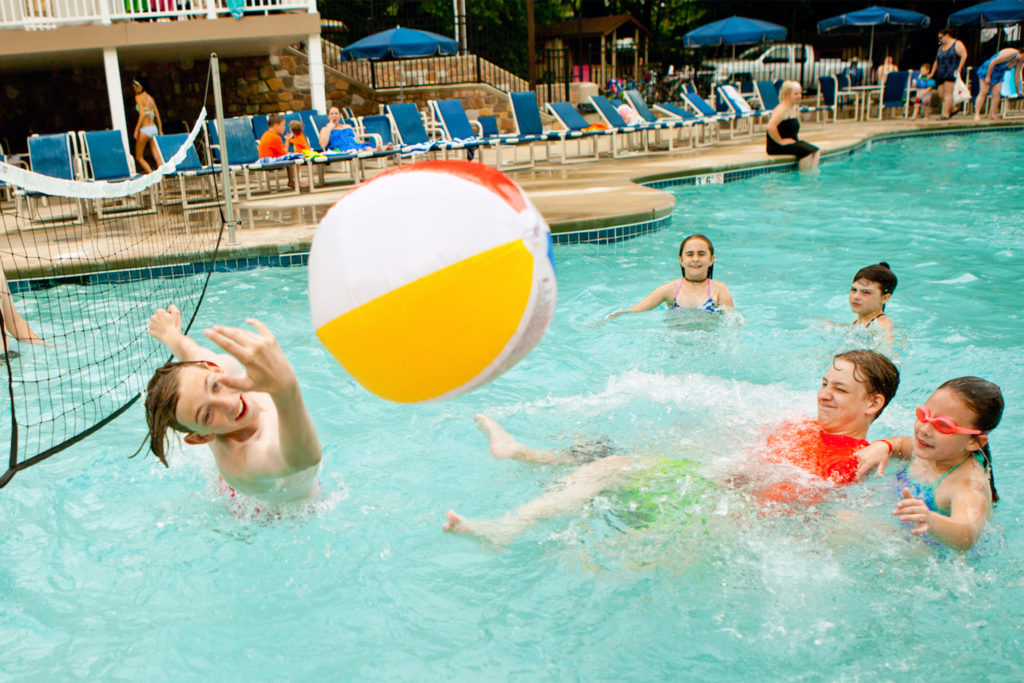 Several kids play pool volleyball at Jellystone Park campground in Quarryville, Pennsylvania.