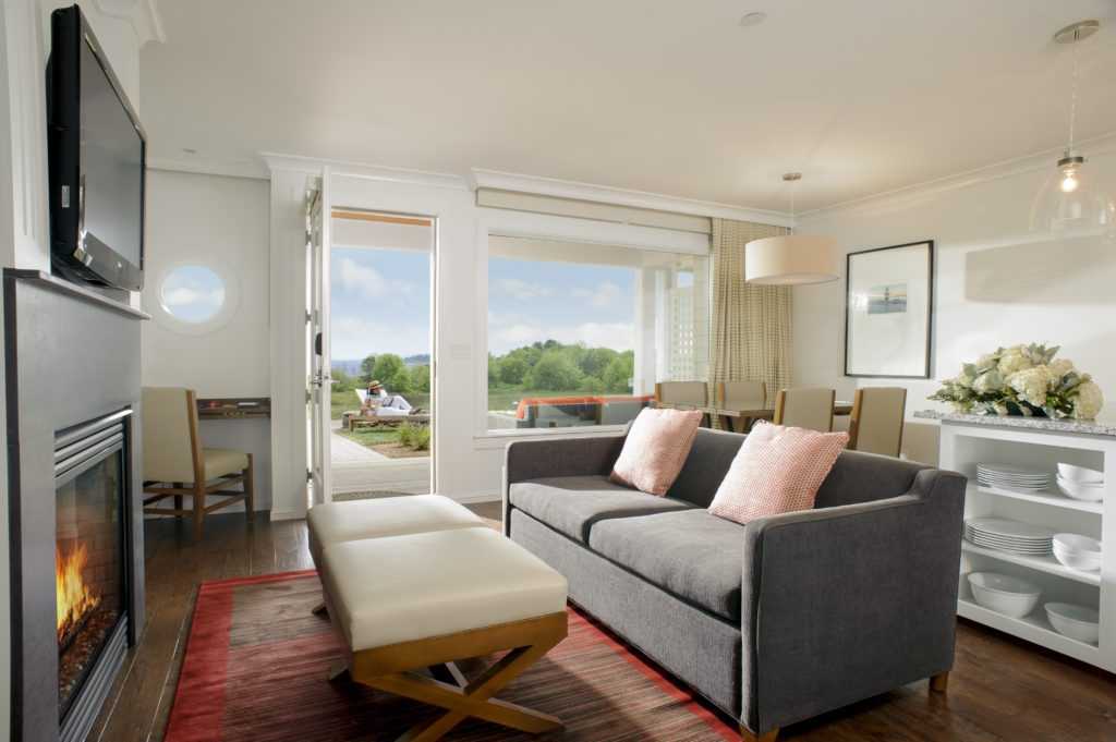 Large hotel suite overlooks the garden at Inn by the Sea in Maine.