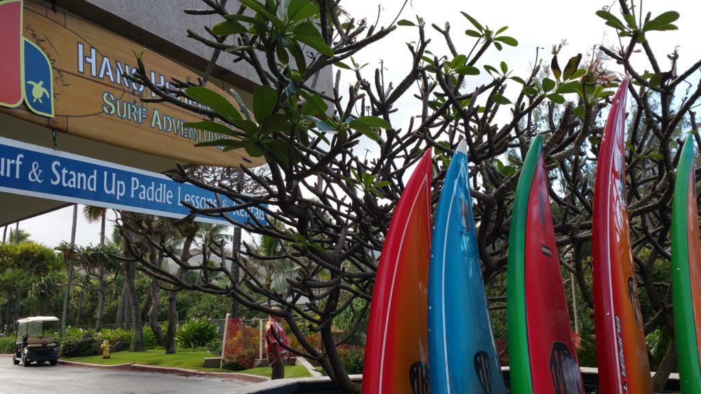 Outside of Hans Hedemann Surf School with rack of sea kayaks at Turtle Bay Resort in Oahu.