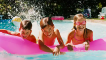 3 kids on floaties in a hotel pool at Southcape Wyndham Resort