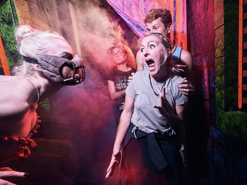 Guests go through Haunted House at Universal's Halloween Horror Nights event.