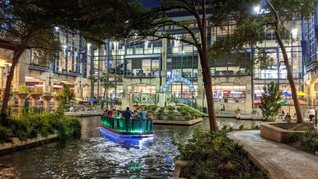 Sightseeing boat lands at Rivercenter Mall along San Antonio River Walk.