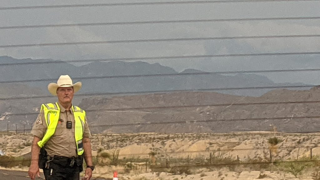 Texas Highway Patrol officer with Big Bend National Park in the background.