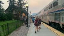 Backpackers disembark at the Amtrak train station at Whitefish, Montana