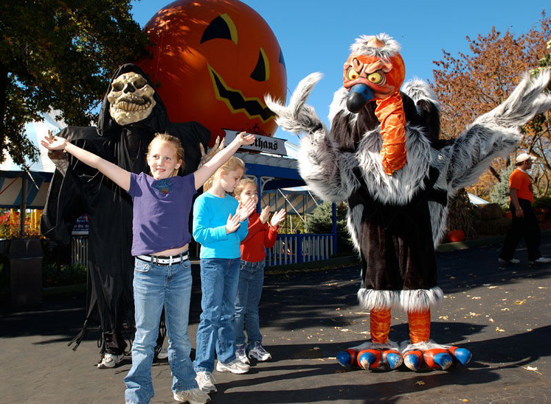 Costumed characters and kids at Worlds of Fun amusement park.