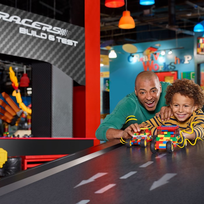 Father and son play with Lego models at Legoland Kansas City.