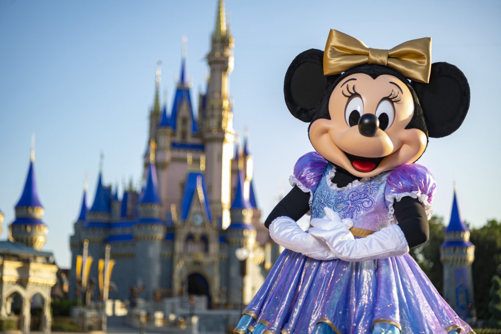 Minnie Mouse is in her sparkling new look, highlighted by embroidered impressions of Cinderella Castle on multi-toned, EARidescent fabric punctuated with pops of gold.