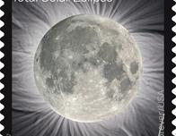 The U.S. Postal Service Total Solar Eclipse stamp as the moon.