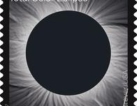 The U.S. Postal Service Total Solar Eclipse stamp looks like an eclipse.