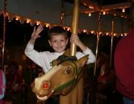 ted on the children's museum carousel