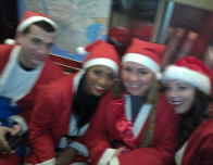 Charity Santas Go to Work on NYC Subways