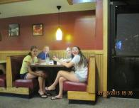 My friends and I Sitting in a Booth Waiting for our Food at Pizza Hut