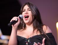 Fedra Vargas-Barrera performs at Best Western convention.