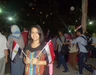 Holding the Egyptian flag during the night protesting