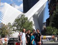 My family poses in front of the WTC Transportation Hub, next to the 9/11 Tribute Center.