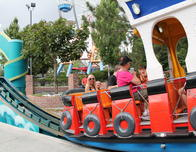 Even Adults Have Fun on the Kiddie Rides at Eltich Gardens