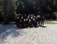 Group pic of us in wetsuits after our journey!