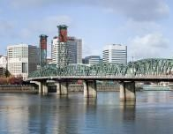 Portland's Hawthorne Bridge-Pano by Cacophony - Own work. Licensed under GFDL via Wikimedia Commons