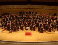 A Shot of the Wind Ensemble on the Stage. I'm the Ginger Flutist in the Second Row, Second to the Left.