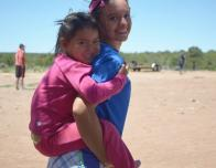 This Young Navajo Girl Named Angel Enjoys a Piggy Back Ride on My Back During Kids' Club One Day