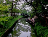 Boats meandering down a Suzhou canal