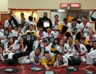 The Dragon Army karate group showing off their awards post tournament at South Point Hotel