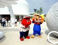 Cuddly mascots roam the grounds to greet all visitors to Expo 2015.