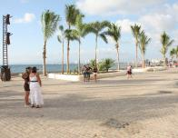 Adults and kids enjoy strolling the Malecon to see the many public artworks.