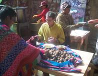 NGO agricultural expert Paul Stapleton aids Peruvians in local potato market.