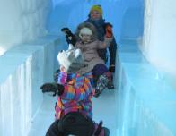 The Grand Slide in the Ice Hotel lobby is fun for all ages.