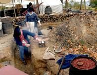 Soldier Cooks on Earthen Kitchen at American Revolution Museum Continental Army Encampment