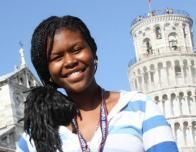 In Pisa, Italy, a girl enjoys the view of the iconic Leaning Tower.