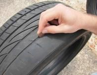 Checking a Cooper Tire's Tread with a Penny
