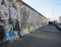 East Side Gallery is displayed on old panels of the Berlin Wall.