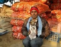Agra, India, onion vendor and puppy